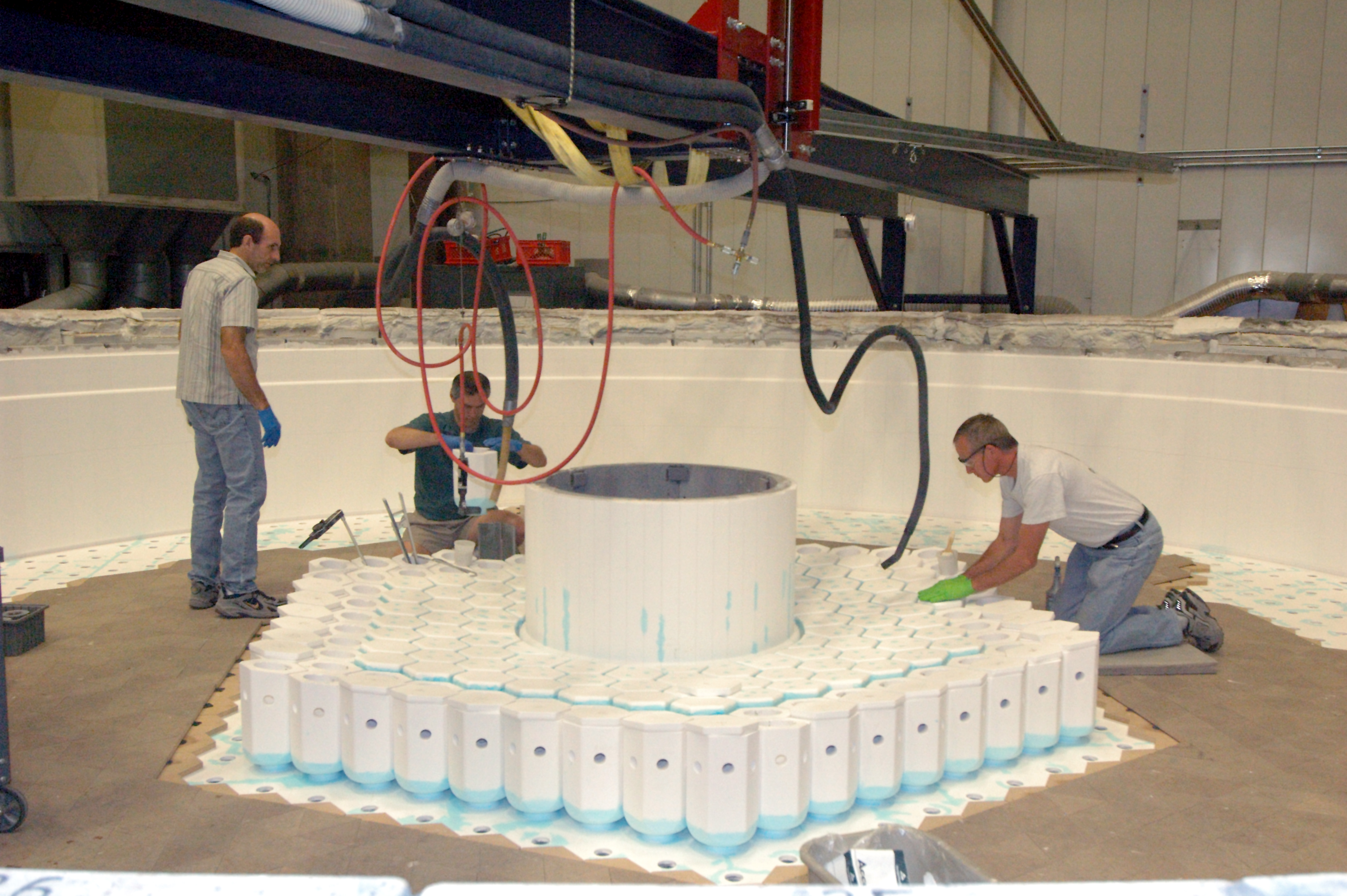 Jim Bracken, Randy Lutz, and Phil Muir (L-R) install cores in the LSST monolithic mirror mold.