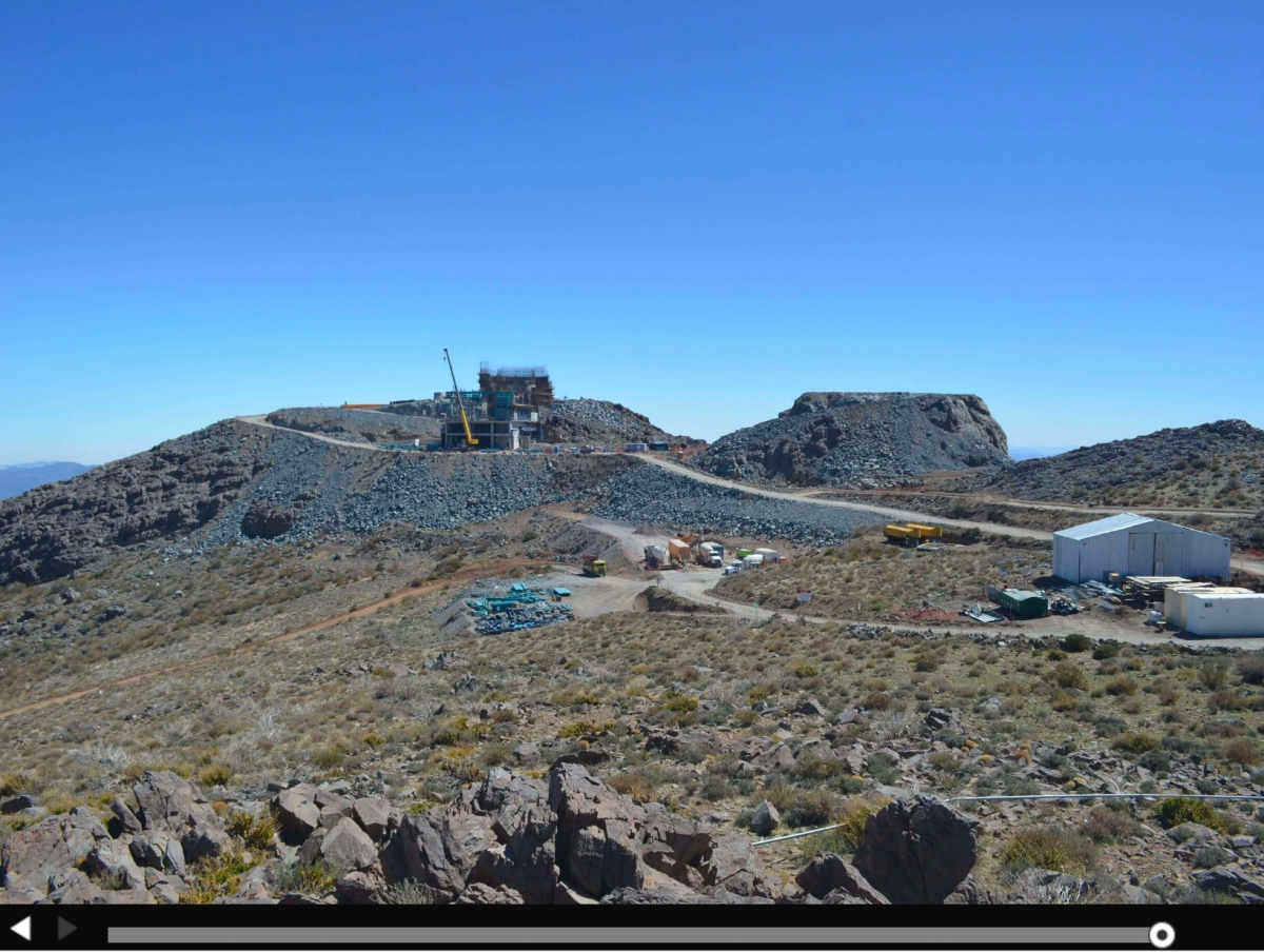 "This camera is on the Cerro Pachón summit, looking north toward the LSST construction site. The summit facilities building will be built into the leveled summit shown in the center of the frame; the Calypso calibration telescope will be located on the leveled ""calibration hill"", located to the right in the picture."